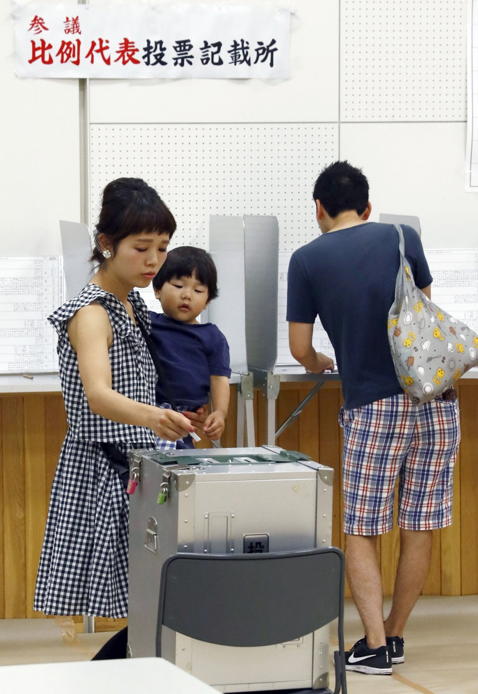 Abe wins upper house poll but suffers constitutional reform setback photo