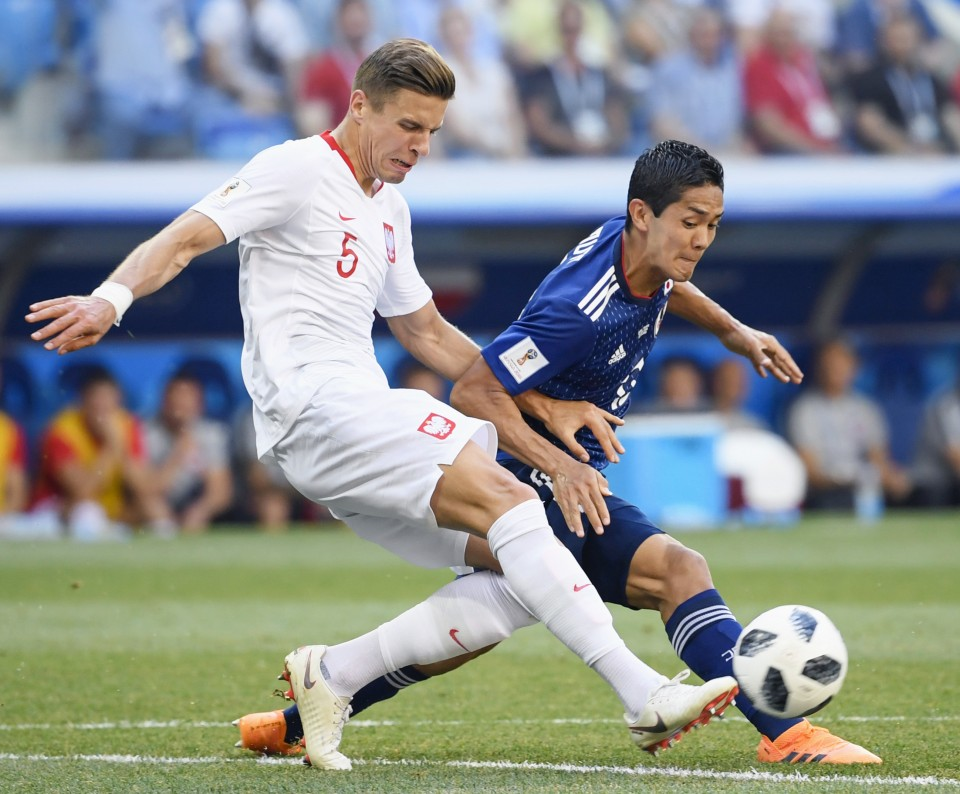 Yoshinori Muto reacts to speculation over a move to Newcastle