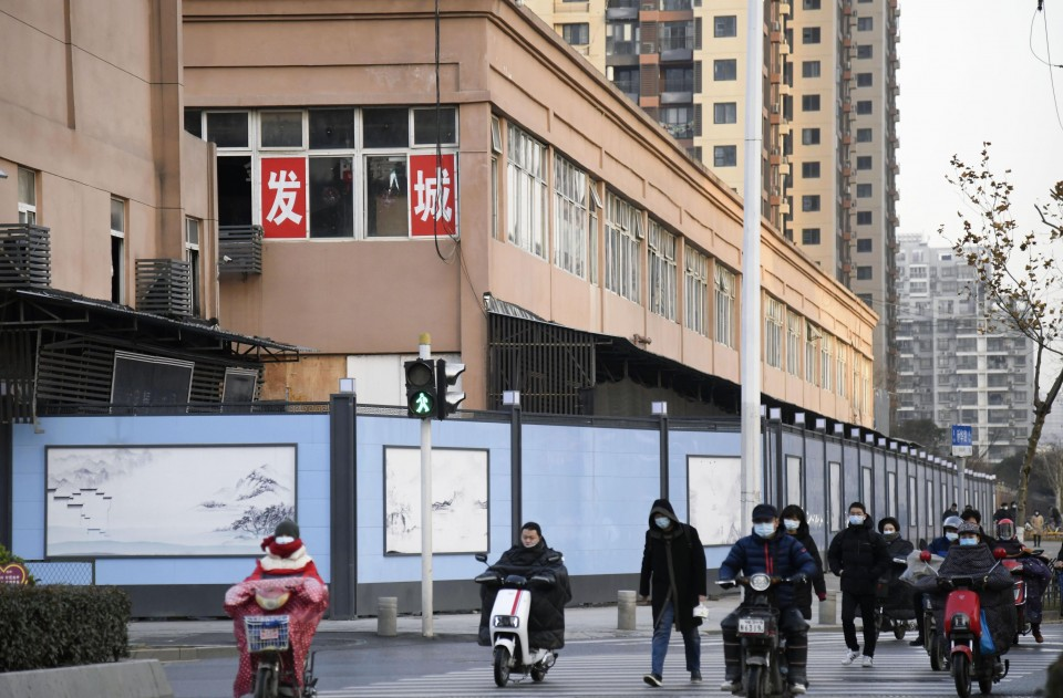 World Health Organization probe team in China leaves quarantine centre in Wuhan