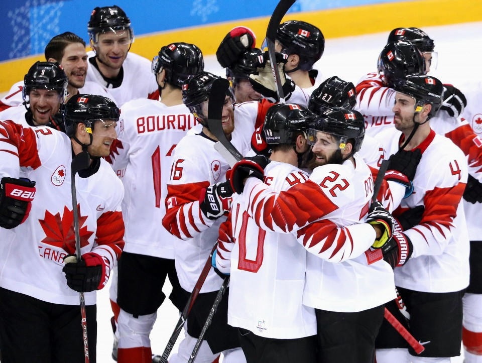 Russia end hockey drought, sing banned anthem