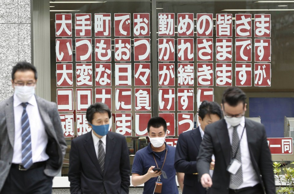 Japan's PM says impossible to hold Games if pandemic persists