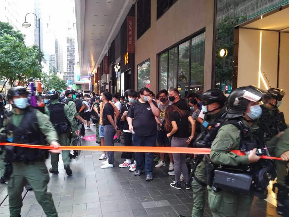 Hong Kong police patrol against protests on China holiday