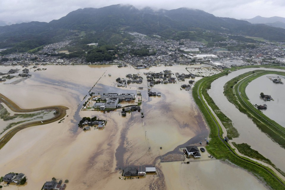 Record rains in southern Japan cause floods, kill two