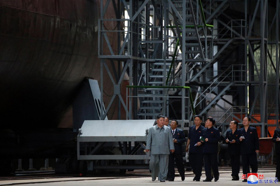 North Korea's Kim Jong Un inspects newly built submarine