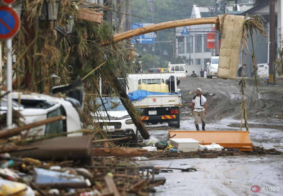 1 dead, 15 feared dead, 9 missing in rain, floods in southwest Japan
