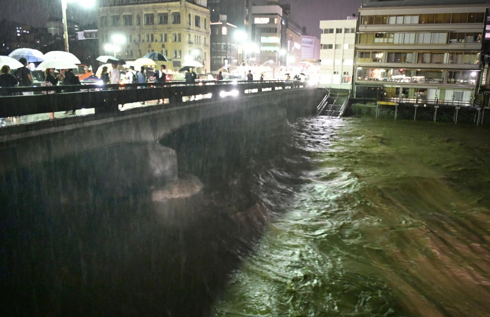 Battering floods in southwest Japan kill 15; over 50 missing