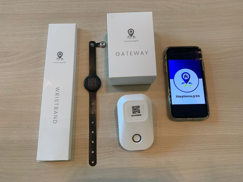 Singapore to require some travelers to wear monitoring devices