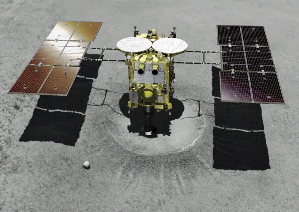 Supplied image shows an illustration of the Hayabusa2 space probe touching down at an artificial crater on the Ryugu asteroid