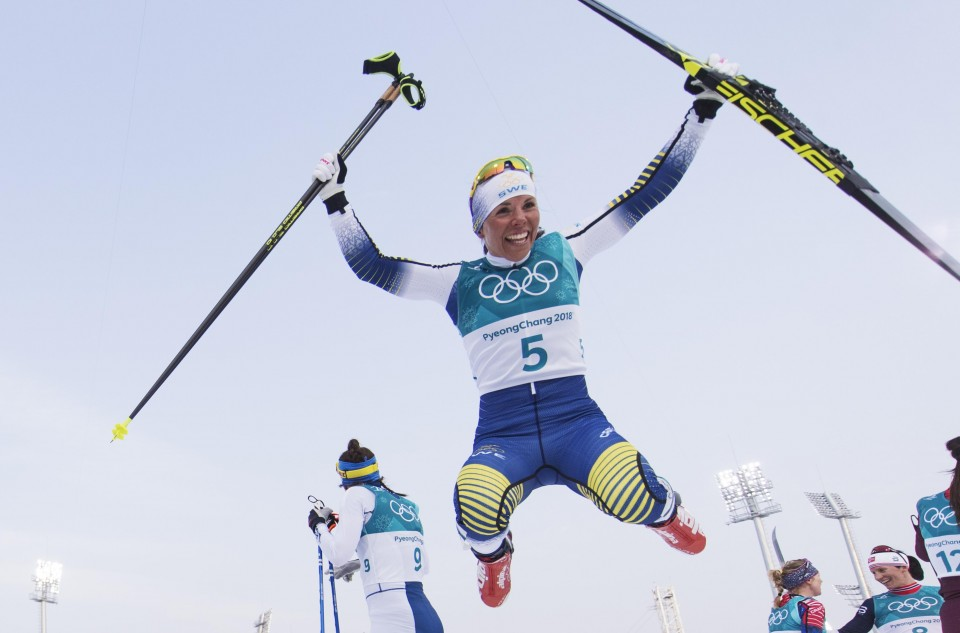 Winter Olympics: Sweden's Kalla takes first gold, Bjoergen makes history