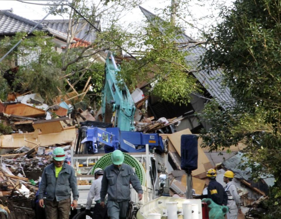 Rescuers hunt for missing as landslides, floods kill 10 in Japan