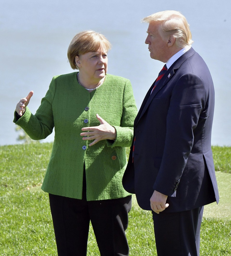 Mic picks up awkward conversation between Merkel and Trump at G7 summit class=