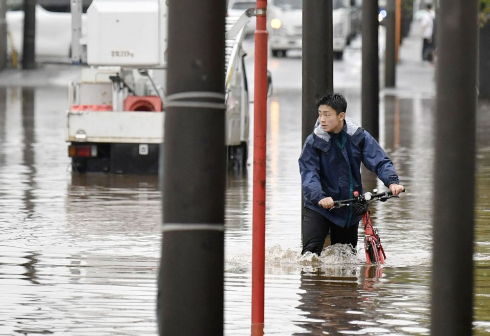 Floods and mudslides from heavy rain in Japan kill at least 10