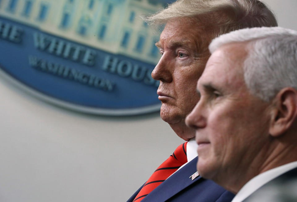 U.S. President Donald Trump and Vice President Mike Pence attend a press briefing at the White House in Washington