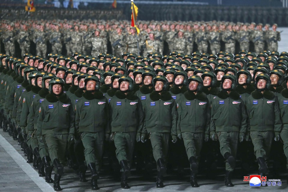 Soldiers march during a military parade in Pyongyang on Jan 14 2021